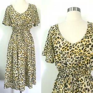 Oh! Mamma yellow leopard print short sleeve dress